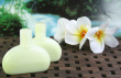 Aromatherapy Oil Bottles With Frangipani Flowers And Rainforest Background. Photo